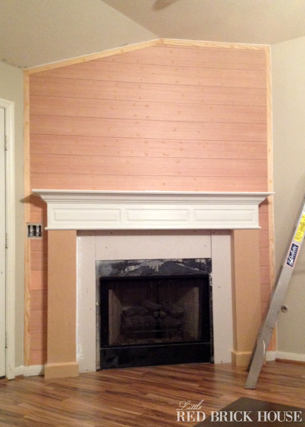 Fireplace makeover planked wall tutorial little red for Tongue and groove fireplace